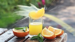 Juicy slices of ripe oranges and orange juice to a glass Stock Footage