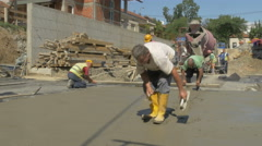 Building construction scene during leveling floor after concreting by Sheyno. Stock Footage