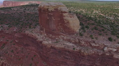 Descending Past Strange Desert Rock Formation at Edge of Cliff Stock Footage
