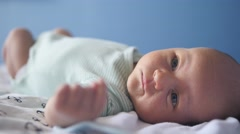 Cute attentive newborn loking at te camera with fun mimicry. Close up Stock Footage