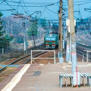 Russian suburban passenger train arriving to station Stock Photos