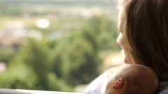 Happy young woman with her baby at a summer sunny day Stock Footage