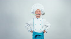 Chef cook holding soup ladle in teeth and smiling at camera. Thumb up. Ok Stock Footage