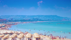 4K NAPLES, ITALY -  Tourists and locals enjoy a sunny beach day Stock Footage