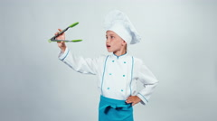 Chef cook playing with kitchen tongs and laughing at camera Stock Footage