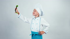 Chef cook playing with kitchen tongs items Stock Footage