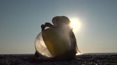 4K Child Playing with Pebbles by Beach Ball, Girl Relaxing on Coastline, Summer Stock Footage