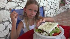4K Girl Eating Saled at Restaurant, Child Eats Vegetables at Tavern, Terrace Stock Footage