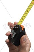 Hand with a rule Stock Photos