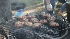 Meat for Burgers Prepared On The Grill Stock Footage