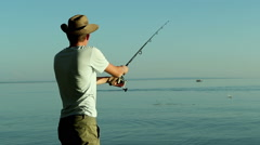 Fisherman on the lake in a cowboy hat. Stock Footage