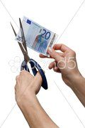 Hands cutting one banknote with scissors Stock Photos
