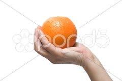 Hand holding an orange Stock Photos