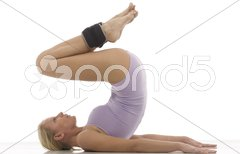 Portrait of a young caucasian woman does gymnastics with ankle weights Stock Photos