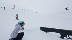 Camera man shoot snowboarder slide on trail at slope, failing. Ski resort in Stock Footage