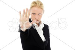 Portrait of a young caucasian businesswoman with aggressive air wearing a jacket Stock Photos