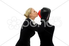 Portrait of a young caucasian businesswoman with aggressive air wearing boxing g Stock Photos