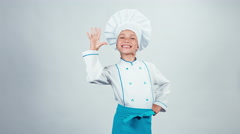 Portrait chef cook child 7-8 years showing okey at camera and smiling with teeth Stock Footage