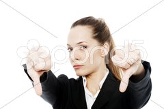 Severe businesswoman with thumb down on white background studio Kuvituskuvat