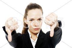 Severe businesswoman with thumb down on white background studio Stock Photos