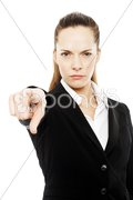 Severe businesswoman with her hand indicating on white background studio Kuvituskuvat