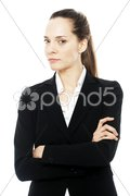 Severe businesswoman with arms crossed on white background studio Kuvituskuvat