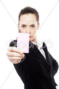 Young businesswoman holding sheets of paper on white background studio Stock Photos