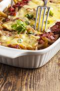 Pasta casserole on dark wood Stock Photos