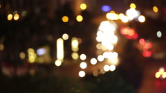 Abstract bokeh of vehicle lights in a dark night in Hanoi, Vietnam Stock Footage
