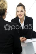 Two women during a business meeting on white background studio Stock Photos