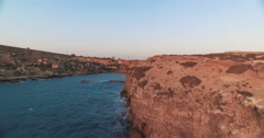 Aerial shot over Popeye Village in Malta during Sunset Stock Footage