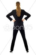 Young businesswoman standing back on white background studio Stock Photos
