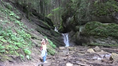 4K Tourist Girl Waving Goodbye by Waterfall, Child View in Mountains Forest Arkistovideo