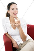 Young woman drinking a cocktail on white background studio Stock Photos