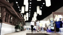 Blurred motion of crowd of people walking in shopping mall Stock Footage