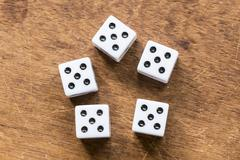 Number five dice on wooden table Stock Photos