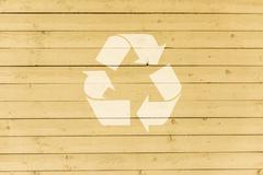 Recycling symbol on  wooden wall of house Stock Photos