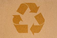 Recycling icon on empty cork noticeboard in office Stock Photos