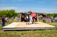 Historical restoration of knightly fights on free festival of medieval cultur Stock Photos