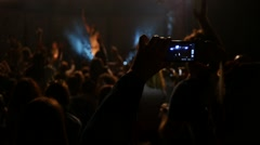 Cheering jumping crowd fan spectators at a concert enjoying in front of stage Stock Footage