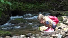 4K Girl Drinking River Water, Child at Camping in Mountains, Kid in Nature Stock Footage