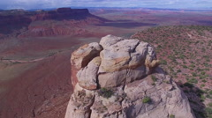 Close Reveal of Strange Desert Rock Formation at Edge of Canyon Vista Stock Footage