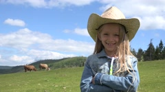 4K Portrait of Laughing Farmer Child Pasturing Cows, Cowherd Girl with Cattle Stock Footage