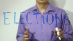 Elections inscription businessman writes on glass video 4k Stock Footage
