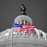 American flag waving in front of the Capitol in Washington D.C. Stock Photos