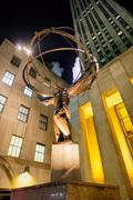 The Statue of Atlas at the Rockefeller Center in New York at nig Stock Photos