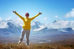 Happy trekking woman winner concept Stock Photos