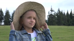 4K Portrait of Smiling Farmer Child Pasturing Cows, Cowherd Girl Face in Nature Stock Footage
