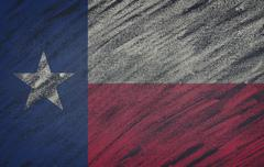Texas flag painted with colored chalk on a blackboard. Piirros