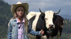 4K Portrait of Farmer Child with Cows, Cowherd Little Girl Face Pasturing Cattle Stock Footage